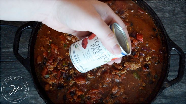 Adding the optional can of tomato paste to the Dutch Oven Chili Recipe for thickness.