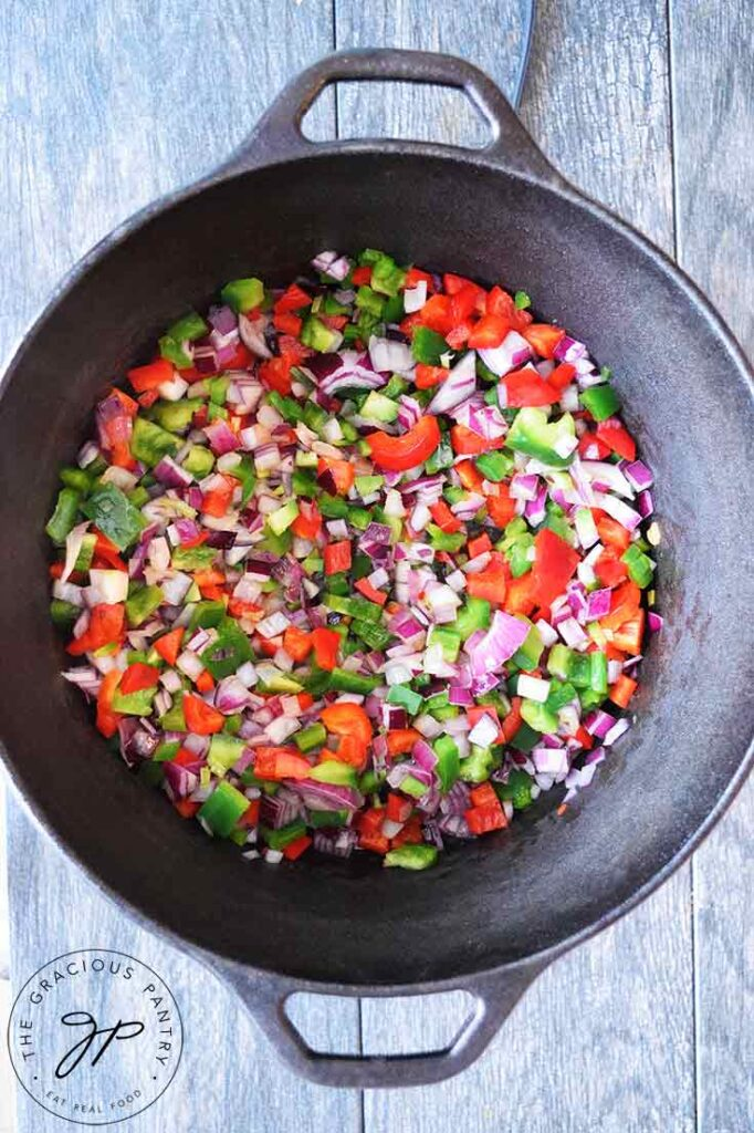 Vegetables sautéing in a dutch oven. The first step in making this Dutch Oven Chili Recipe.