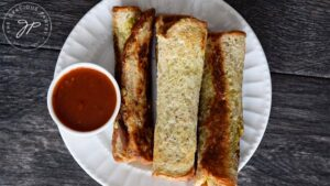 Serving the Grilled Cheese Roll Ups with a side of marinara for dipping.