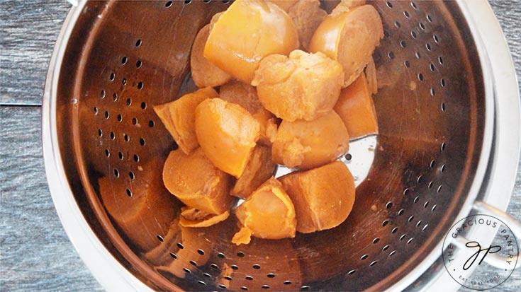 The persimmons, transferred to a colander to be mashed.