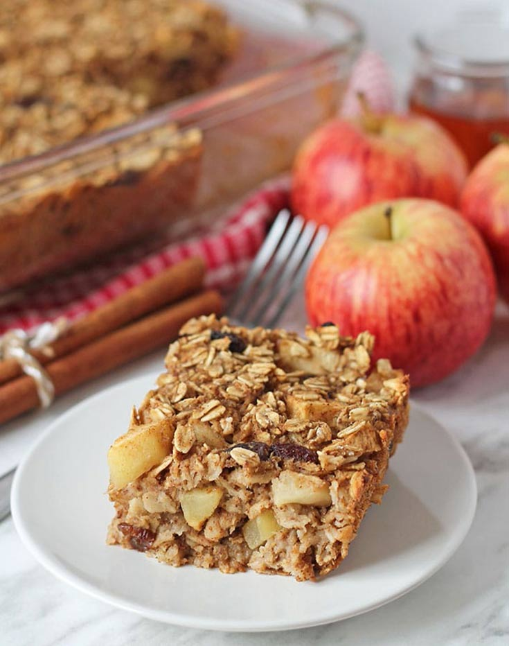 A slice of Vegan Baked Apple Oatmeal sits on a plate, ready to eat.