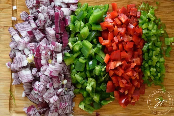 Chopped veggies freshly cut for making this Dutch Oven Chili Recipe.