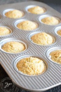 Just baked Gluten Free Lemon Poppy Seed Muffins still in their baking pan cooling.