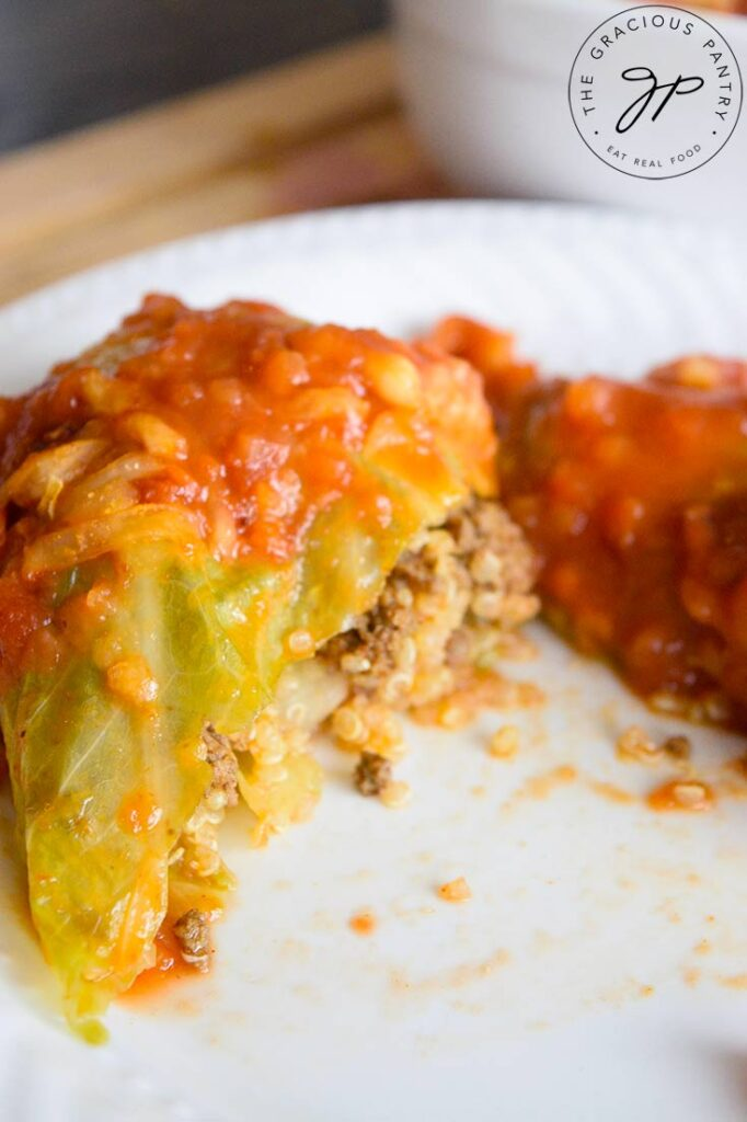 The finished Mexican cabbage rolls. One on a plate, cut open.