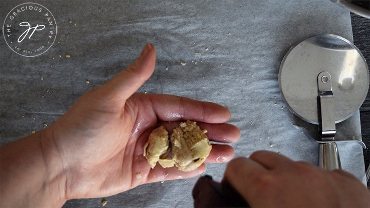 Keeping the remaining dough moist by spritzing it with a bit of oil.