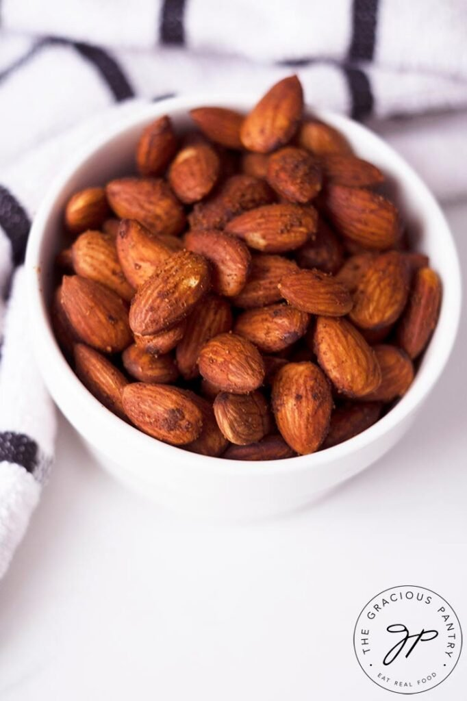An overhead view of the almonds din a small white serving dish.