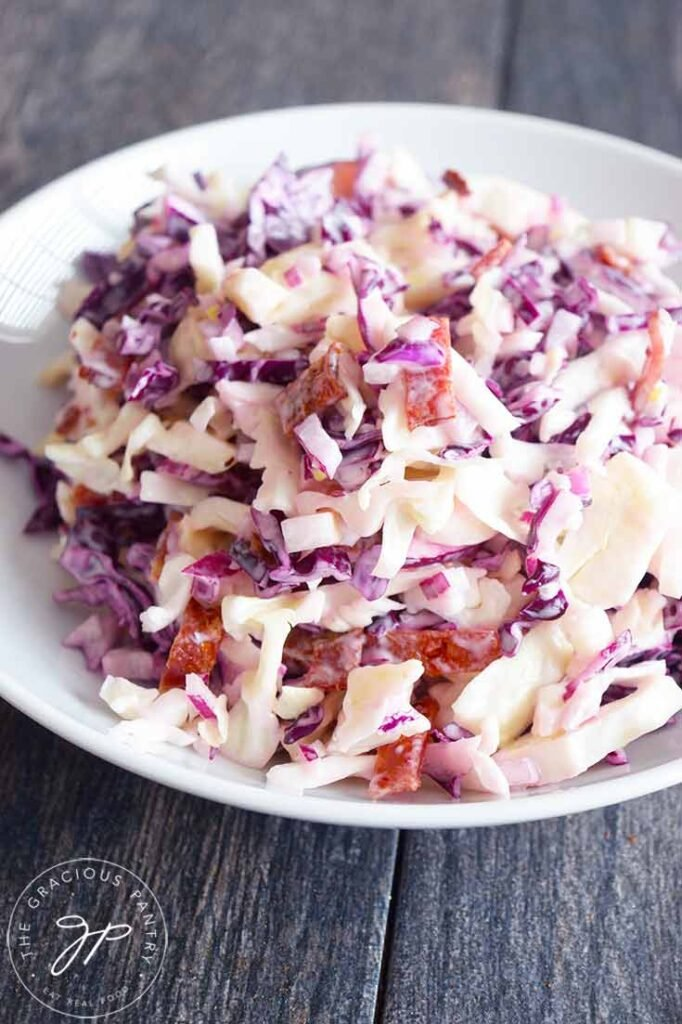 A front view of this Cabbage Salad recipe in a white bowl.