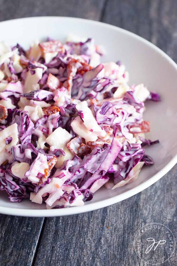 A sideview of this Cabbage Salad recipe in a white serving bowl.