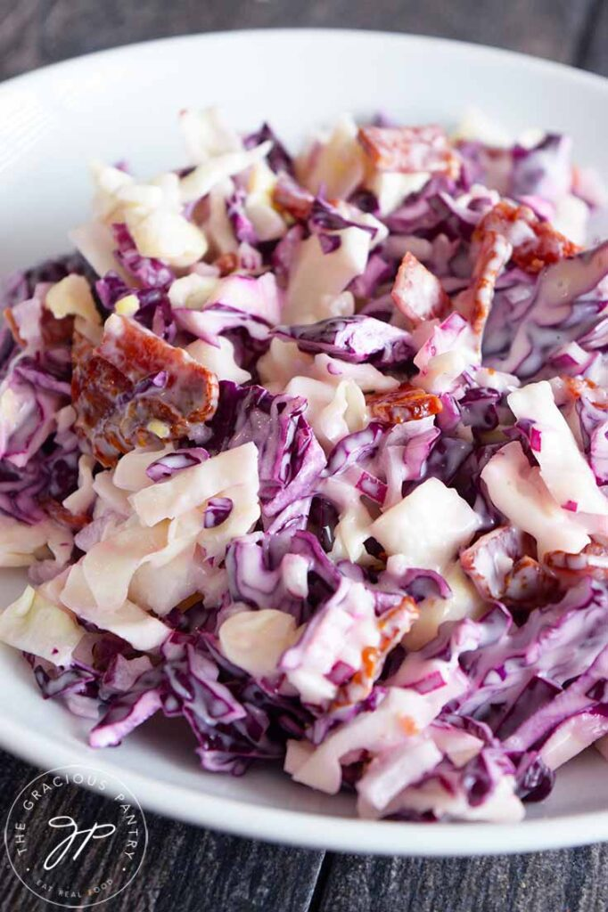 And up close view of this Cabbage Salad recipe. You can see the bacon bits scattered throughout the green and purple cabbage.