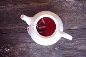 The water added to the tea pot.