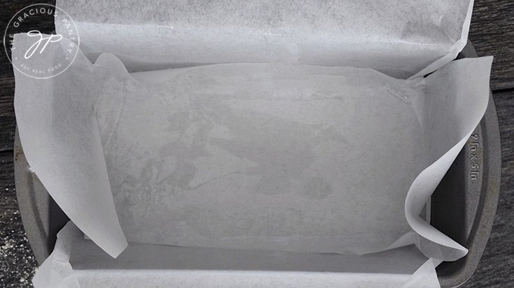 A loaf pan, lined with parchment and sprayed with oil.