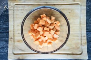 The chopped sweet potatoes in the mixing bowl for this Roasted Potato Salad Recipe.