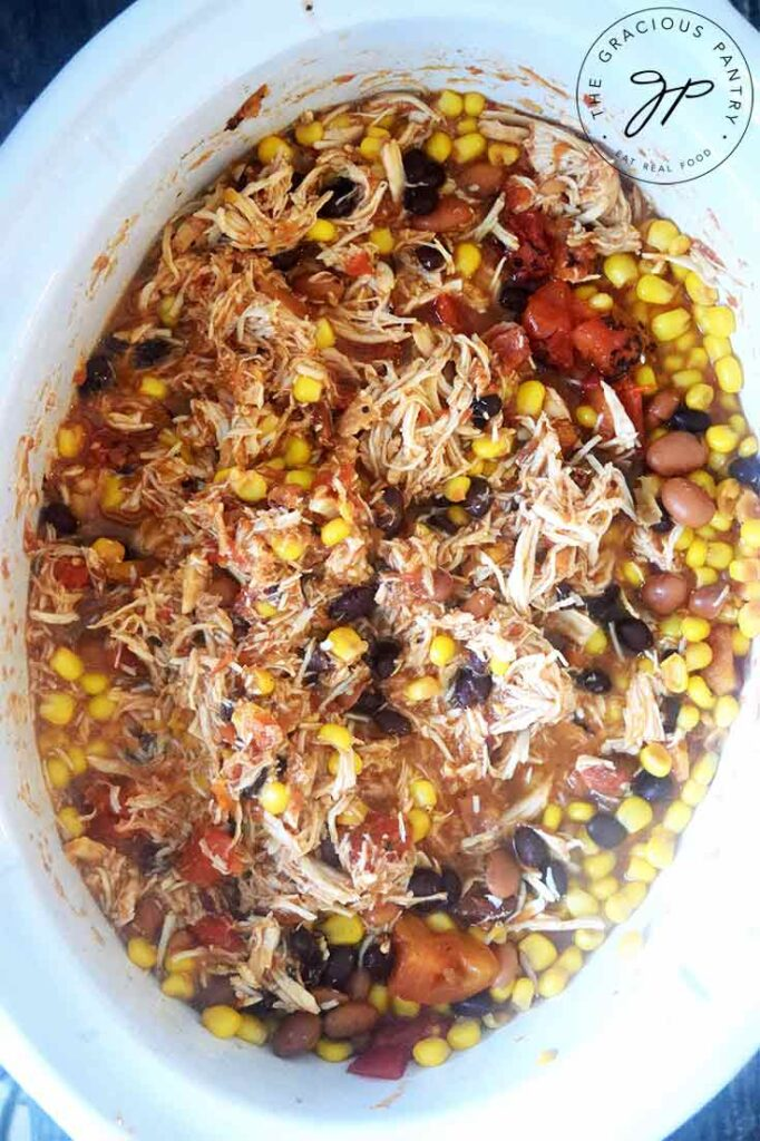 Slow Cooker Southwestern Chicken, just shredded and still sitting in the slow cooker.