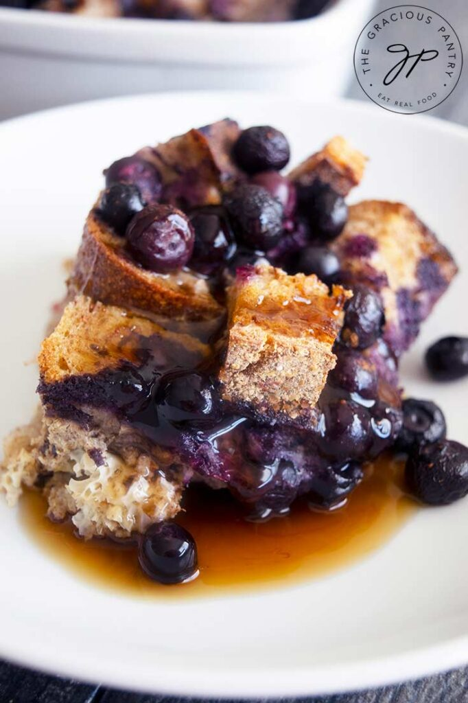 A serving of Blueberry French Toast Casserole served on a white plate.