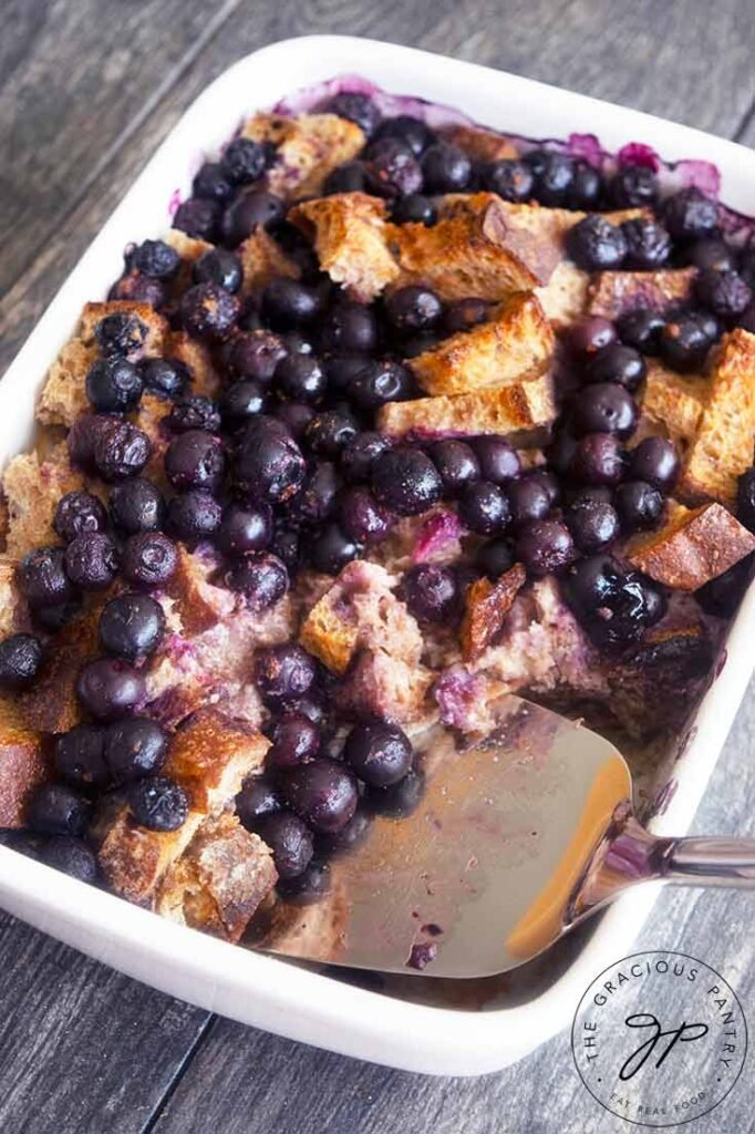 Blueberry French Toast Casserole in a white casserole dish.