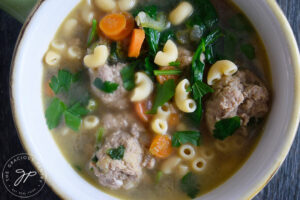 The finished Healthy Italian Wedding Soup Recipe in a white bowl.