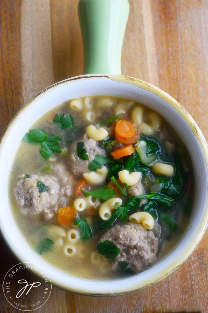And overhead view of a crock filled with this Healthy Italian Wedding Soup.