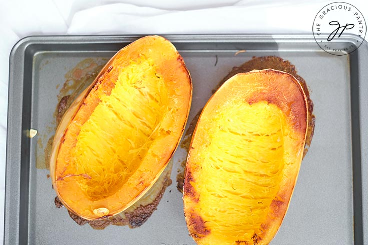 The roasted spaghetti squash, golden brown from baking.