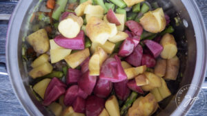 Adding the potatoes to the pot for this Spring Minestrone Soup Recipe