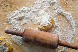 A portion of dough on a floured surface, read to be rolled out to make this Sweet Potato Flatbread.