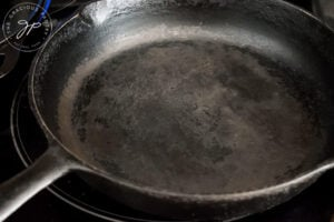 A cast iron skillet sits on the stove, ready to cook this Sweet Potato Flatbread.