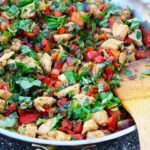 A sliver skillet filled with this Bell Pepper Chicken Recipe.