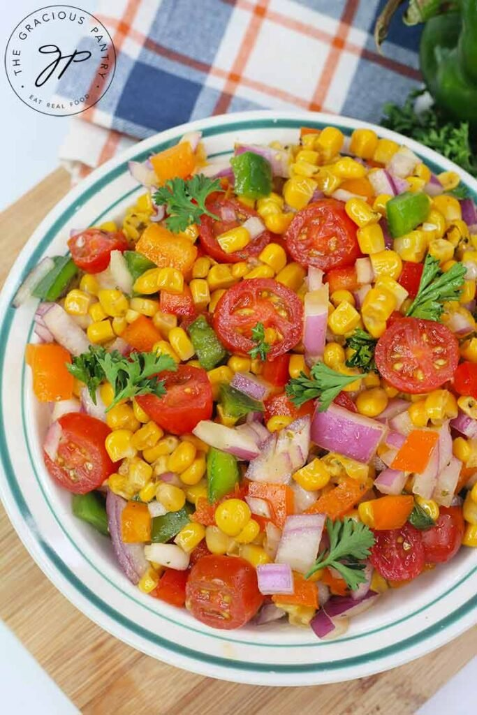 An overhead view looking down into a bowl filled with this Cajun Corn Salad Recipe