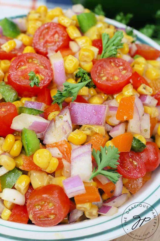 An up close view of a bowl of this Cajun Corn Salad Recipe.