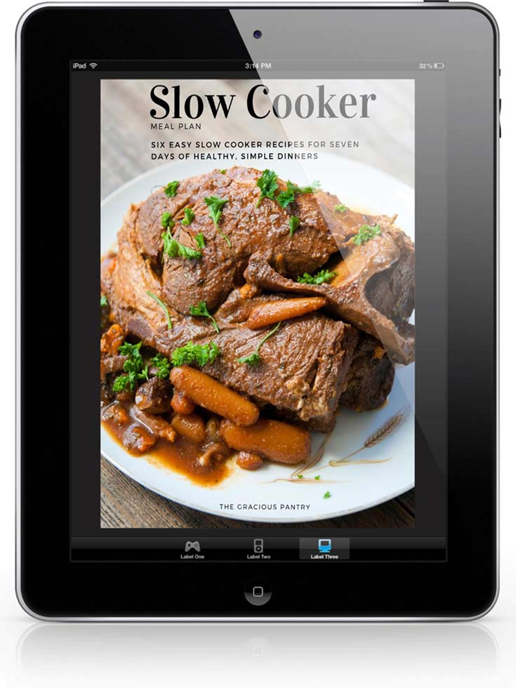 The cover of this Slow Cooker 7 Day Meal Plan displayed on a black iPad.