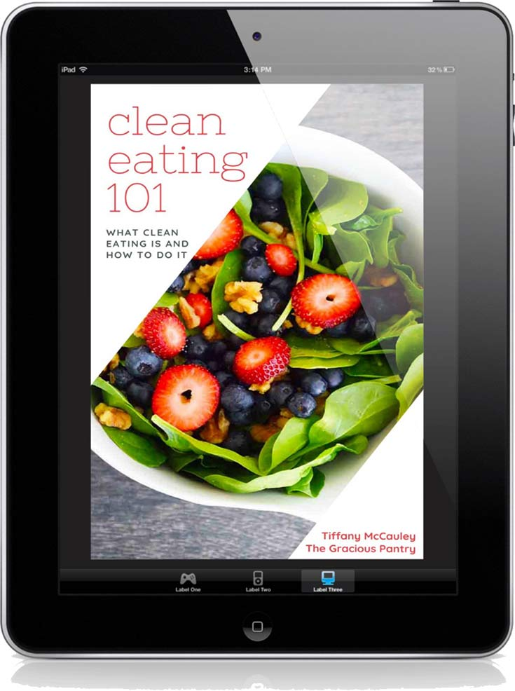 The cover of this Clean Eating 101 eBook displayed on a black iPad.