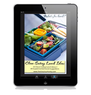 The cover image of this Clean Eating Lunch Ideas ebook displayed on a black iPad.