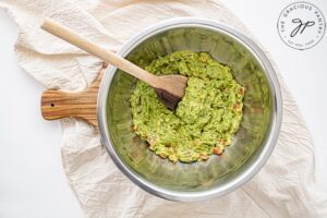 The guacamole all mixed together in a mixing bowl.