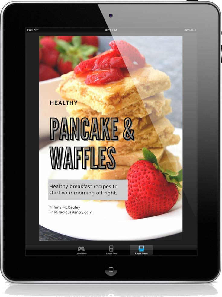 The cover of this Healthy Waffle & Pancake Recipes eCookbook displayed on a black iPad.