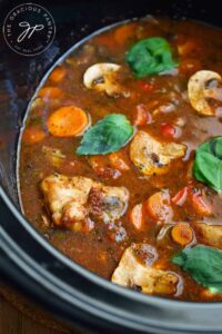 An up close view of Slow Cooker Chicken Cacciatore still on the crock.
