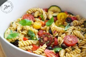 The finished Vegetable Pasta Salad Recipe in a white serving bowl.