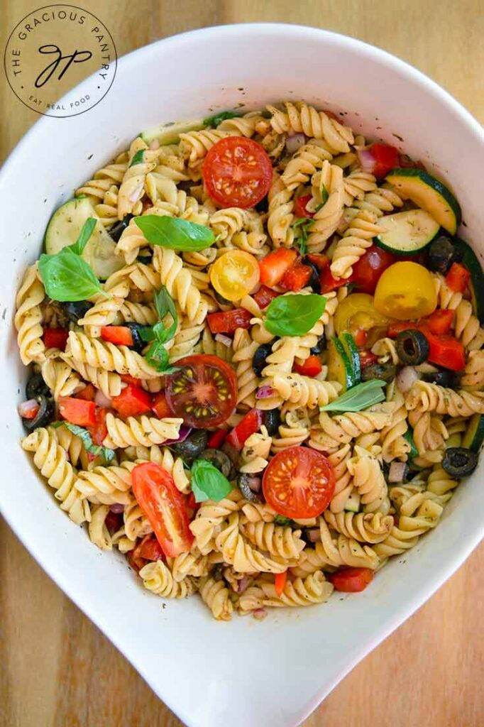 An overhead view of this Vegetable Pasta Salad in a white serving bowl.