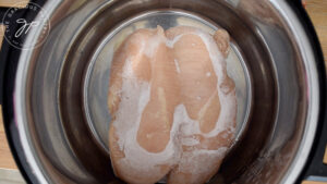 Frozen chicken breasts sitting in an Instant Pot.