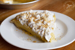 A single slice of the finished coconut cream pie on a white plate.