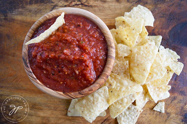 The finished restaurant salsa in a bowl with corn chips on the side.