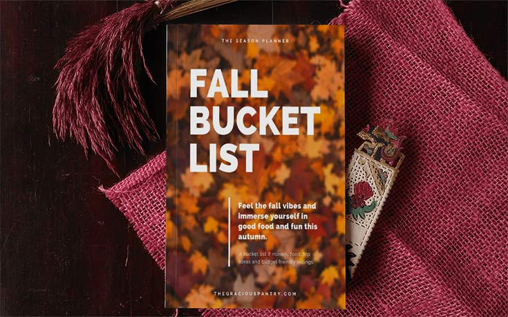 Fall Bucket List Cover displayed as a book, laying on some fall colored blankets (this is not a physical book. It's a digital download)