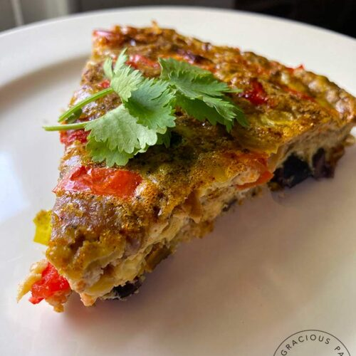 A single slice of this Southwestern Crustless Quiche on a white plate.