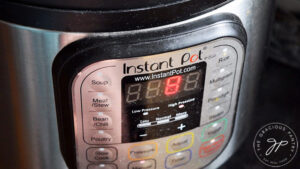 The timer on the Instant Pot adjusted to 8 minutes for cooking.
