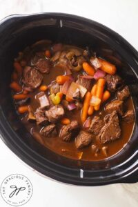 An overhead view looking down into a slow cooker filled with this Bison Stew Recipe.