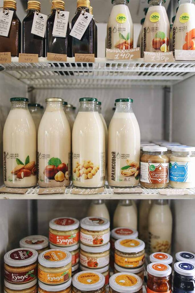 A fridge filled with healthy dairy free snacks and milks.