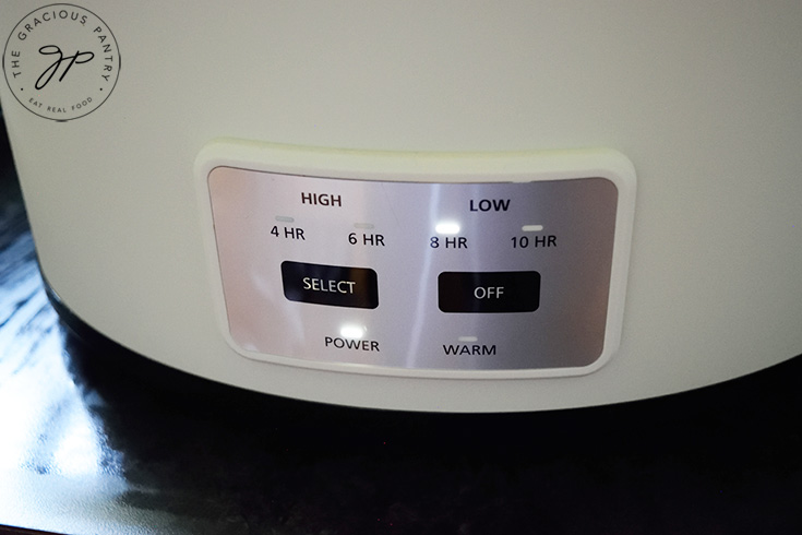 A slow cooker, set to low heat for 8 hours of cooking.