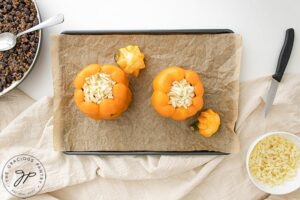 Placing the peppers on a baking pan.