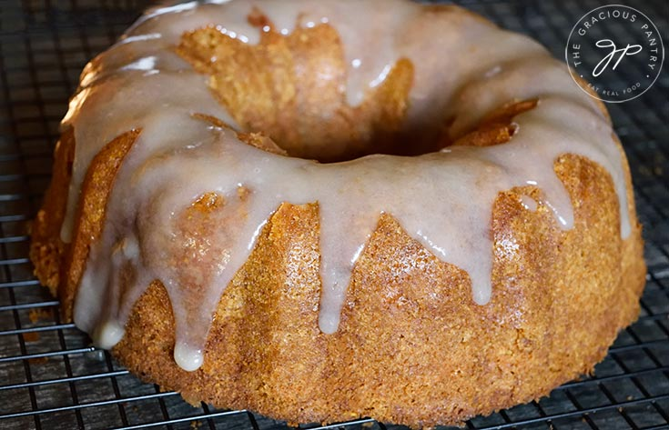 The finished Spiced Apple Bundt Cake Recipe with caramel drizzled over the top.