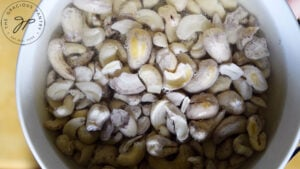 Cashews soaking in a bowl of water.