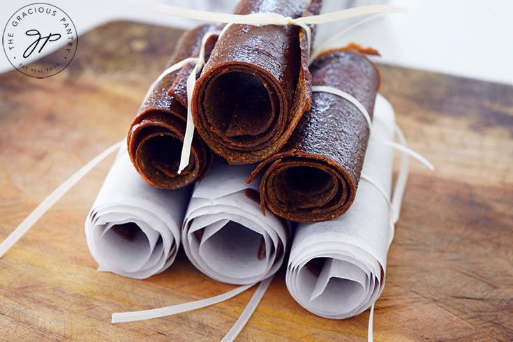 The finished pumpkin fruit leather roll-ups.